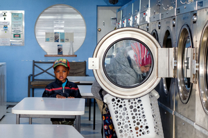 Boy in laundromat