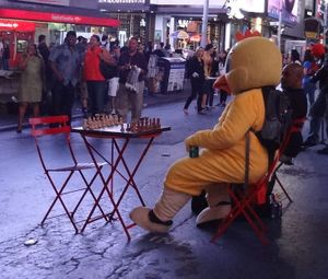 Rooster Awaits  Chess Player in Times Square