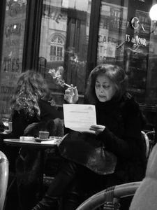 An Asian lady has a break in Paris Cafe