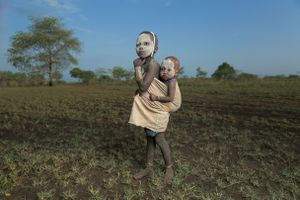 A portrait of two young Mursi kids.