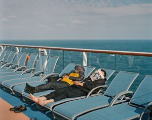 Passengers taking a break on deck.