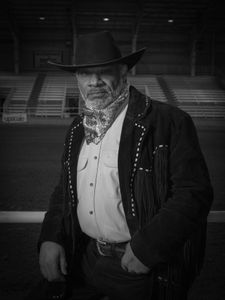 "Bruce Clark, AKA ""Doc"", AKA ""Doc Holliday"", rides his Tennessee Walker with the Sunset Saddle Club in Memphis, TN. He was photographed at the Bill Pickett Rodeo in Memphis, TN on March 28, 2015."
