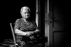 The old Lady by the door