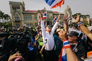Controversial Thai politician Chuwit Kamolvisit celebrating with anti-Government protesters in front of Government House in Bangkok, Thailand. Police removed barriers preventing access to the Government complex following a week of violent clashes.