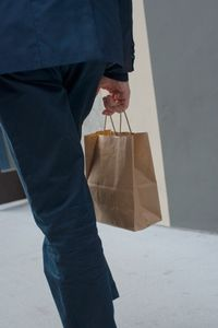 Man with Paper Bag
