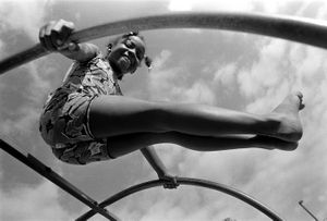 Camillia Whiteside (7) does gymnastics exercises. Ethnicity:  Mexican • Spanish • English • Cuban • European • African  ©2014, Stephen Shames