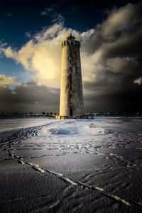 Pathway to the snowy lighthouse