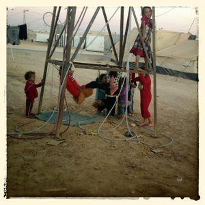 Children play under a water tower