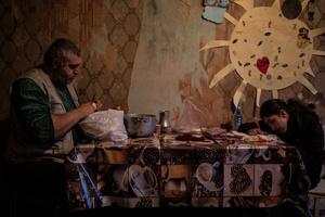 Knyaz prepares dinner for his daughter Astghik (10).