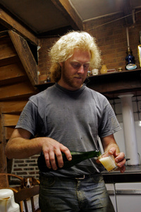 Laurent Delaporte pours a glass of cider that he makes using artisanal methods on his father's farm