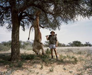 untitled professional hunter with trophy lion.kalahari, northern cape, south africa-from the series 'hunters'-David Chancellor