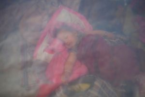 A child is sleepin in a makesift camp in Durbar Square, Katmandu, nepal, 03 May 2015.