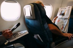 Men in business class read about markets
