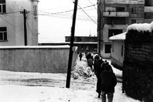 A group of men on their way to the cemetery. In keeping with Albanian tradition, the men stay separated from women during funerals. Tropoja, Albania © Enri Canaj