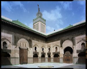 Courtyard and minaret of Bu Inaniya Madrasa in Fez, Morocco.