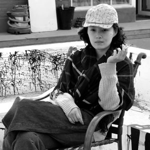 Woman Smoking at a Beijing Cafe