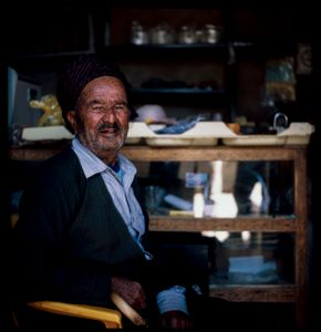 A Kurdish  man With traditional clothes In his own shop from Hawraman Takht ,Kurdistan of Iran