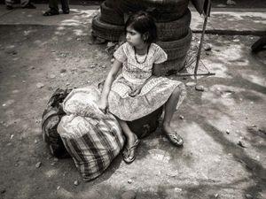 Young girl at a bus stop, Biratnagar, Eastern Nepal