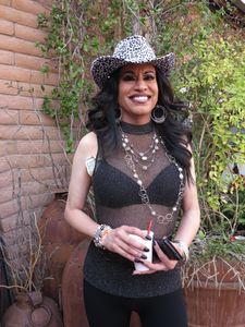 Woman wearing leopard print hat, Phoenix, 2015