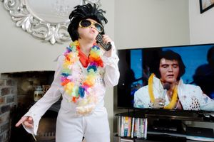 Six year old Elvis impersonator LD performing in his front room with his idol, Sheffield 2017