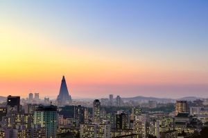 Sunset over misty Pyongyang with the  iconic Ryugyong Hotel peaking out in the distance.