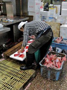 preparing neat slices of fish