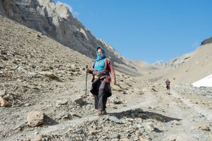 A woman returning to camp after a day's search. Upper Dolpo, Nepal, June 2017.