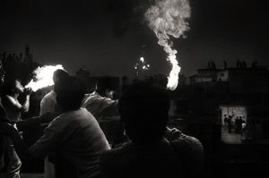 Fire breathing from a rooftop. Shakhari Bazar, 2008. © Munem Wasif
