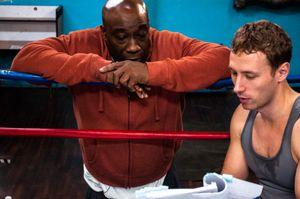 Actor Michael Clarke Duncan & actor/director Kent Moran, review the script before a scene.