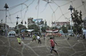 A group of Muhamasheen boys play football against another team in Sanaa's Tahrir Square.