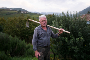 Aldo Mole returns everyday at the sunset from his work in the field. He has just  got it ready for the sowing. – Cossano Belbo (Cuneo), Piedmont, Ita