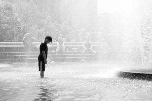 kid in the fountain