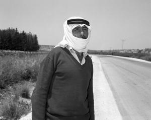 arab man waiting for a taxi