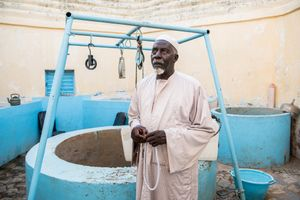 November 06, 2017. Serigne Touba Khouma is the caretaker of the fountain at the tomb of Sokhna Mame Diarra Bousso (1833-1866), the mother of Amadou Bamba. As in Lourdes, the faithful are hoping for healing, strength and blessing from the holy water of this fountain. At the mausoleum of Sokhna Mame Diarra Bousso in Porokhane thousands of believers gather once a year for a pilgramage, called Magal.