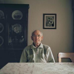 Grandfather sitting.