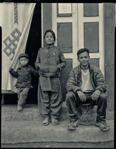 Everest porter Moti Magar at Lukla with 11year-old Kamita Tamang and toddler Sonam Sherpa