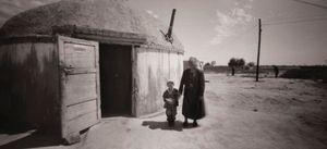 Khazak woman and child, Khazak Reservation, Xinjiang Province, China