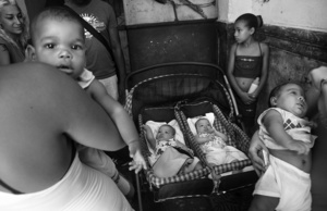 Some young mothers gather with their babies to chat and they share their experiences after attending to a checking routine in a Community Medical Center.