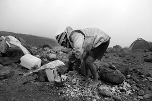 Porter preparing tea for foreign trekkers