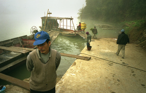 Workers and villagers board a ferry - Guangdong province, China.