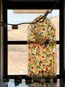 """Naval Base Museum Pane made of Pieces of Glass from Gtmo Beach from """"If The Light Goes Out: Home from Guantanamo"""" © Edmund Clark"""