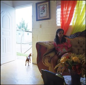 Cristal, in the house where she rents a room, before going in to work