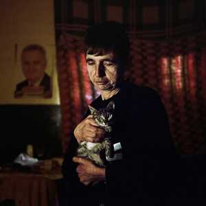 Mitrovica North, Kosovo, November 2013. Bisenka, 50 years. She lives in North Mitrovica, in a former elementary school which has become a refugee camp for 250 veterans after the war. Today, in addition to her there are three other families living amongst garbage, filth and excrement.