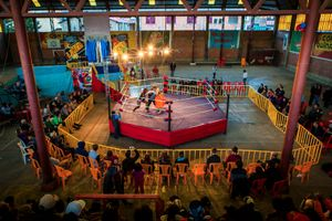 The ring of the 12th October Sports Complex, where cholitas fights happen every Sunday. The fights attract many Bolivians and tourists. Tourists pay five times higher prices to sit in the front rows on plastic chairs, while locals sit on the cement stands.