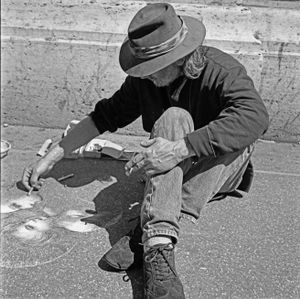 Artista working on the pavement, Roma, Italia