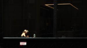 Woman at Café Window