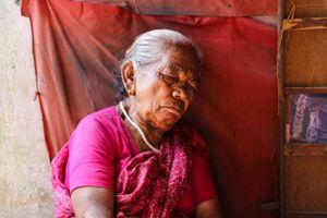 Sleeping Nepalese street seller