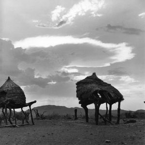Toposa traditional house and background landscape