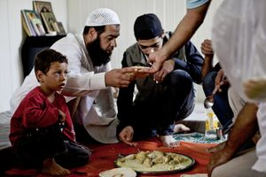 Supper in the container home of one of Zaatari's imams. © Tom Verbruggen
