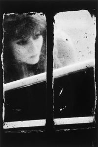 "Dirty Windows Series #19, 1994. © Merry Alpern. International Center of Photography, Gift of David and Kim Schrader, 2010. Shown at the exhibition ""Public, Private, Secret,"" showing at the ICP in New York City."